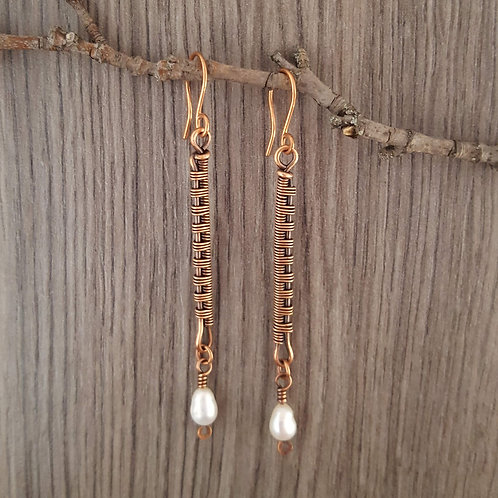 Copper wire woven dangle earrings with freshwater pearls.