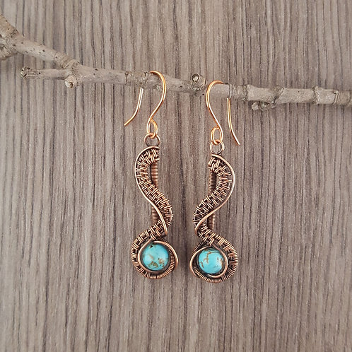 Copper wire woven earrings with turquoise beads.