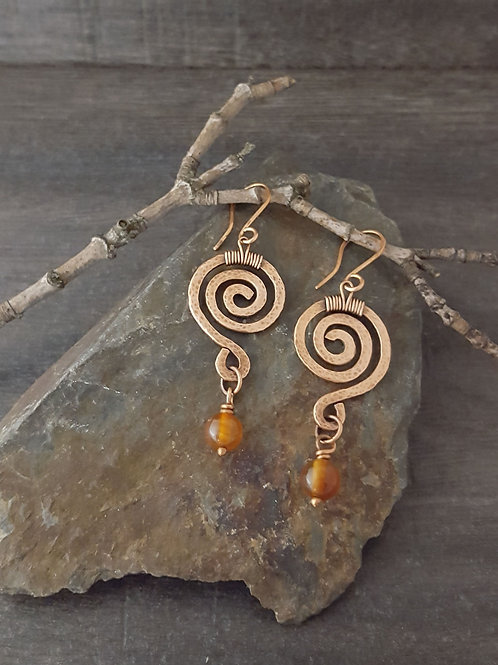 Hammered copper spiral earrings with carnelian beads.
