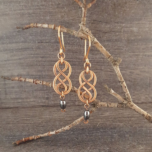 Celtic style infinity earrings with hematite beads.