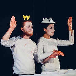 Lord and Lady Macbeth wave.