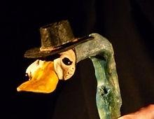 A wooden duck dances.