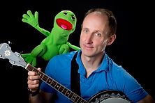 Glen Caradus posing with frog and banjo.