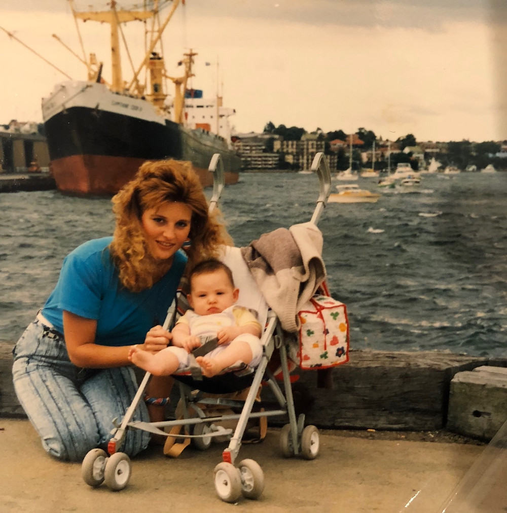 My mum at 22 with me as a baby.