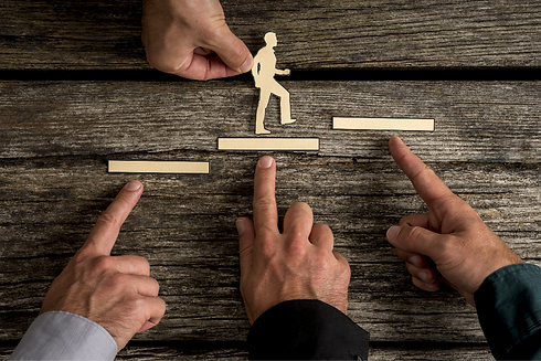 Business teamwork and cooperation concept with the hands of four businesspeople supporting