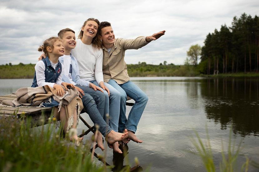 full-shot-happy-family-outdoors.jpg
