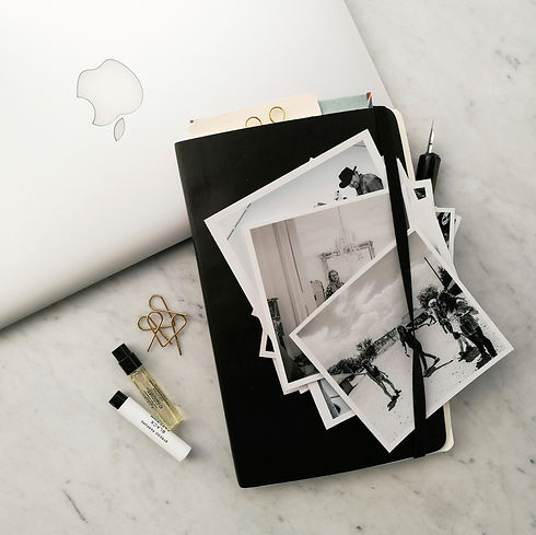 flatlay with macbook and polaroids