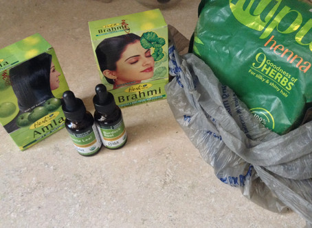 Promotes Thicker Hair With Herbal Powder: Amla, Brahmi, and Godrej Nupur Henna Paste
