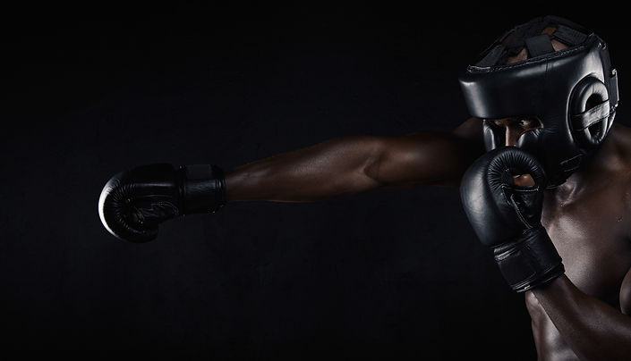 Image of african male boxer boxing again