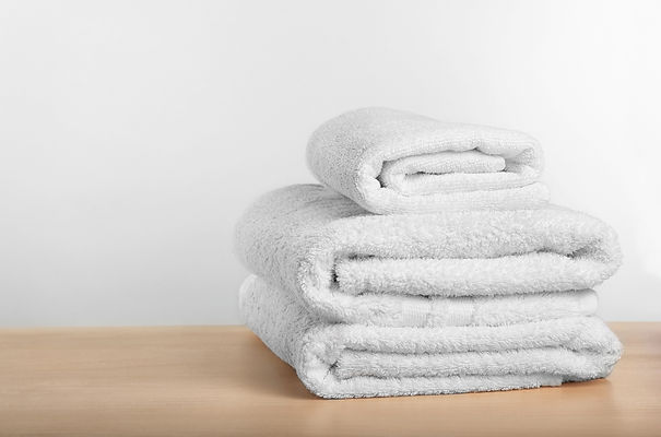 Clean towels on table against light back