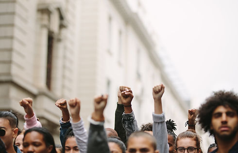 Arms raised in protest. Group of protest