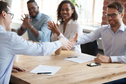 Smiling business partners shake hands af
