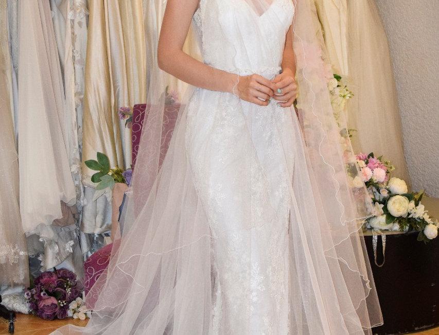 Vestido de novia en tules con falda sirena