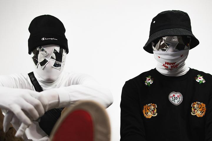rising hip-hop group The Image wearing masks