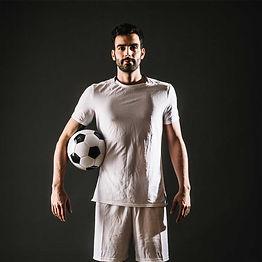 soccer-player-holding-ball.jpg