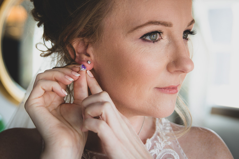 Purple wedding earrings by Steve and Tania Photography