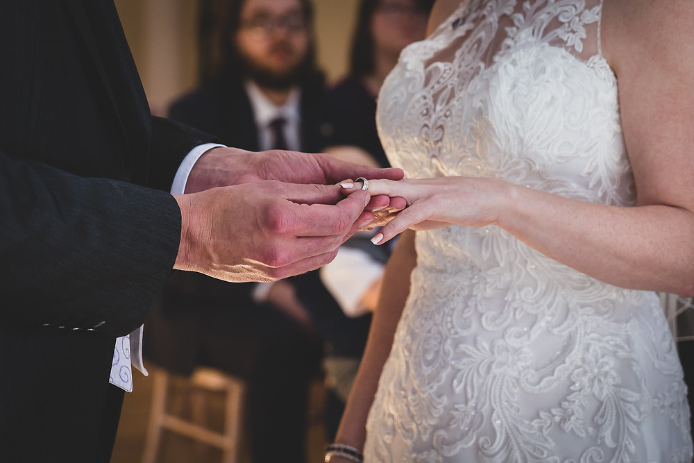 putting on the wedding ring perfectly by Steve and Tania Photography