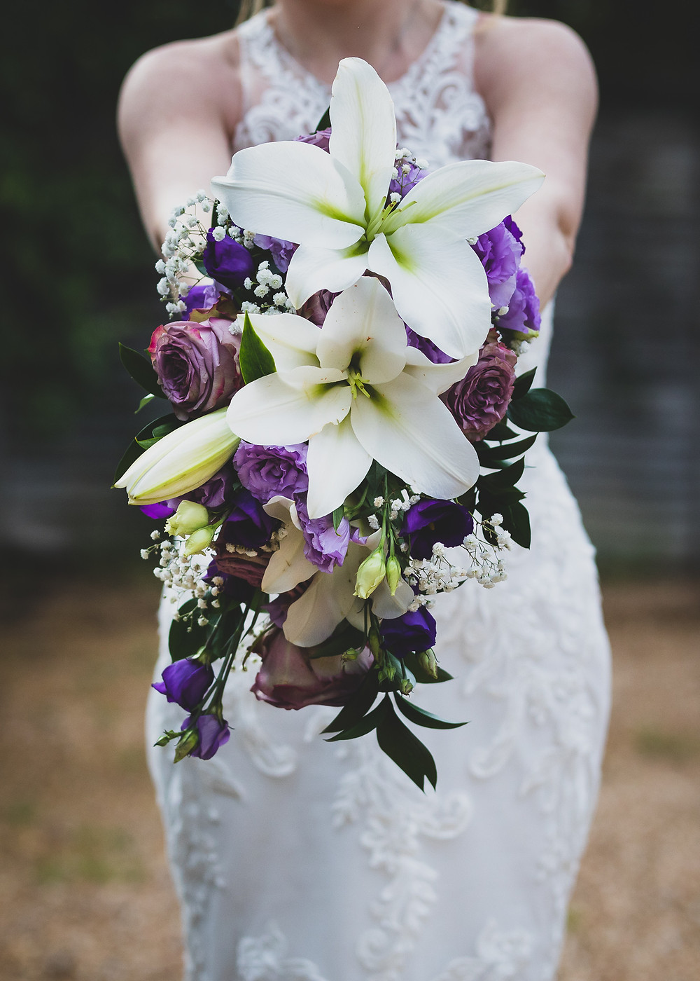Purple and white wedding bouquet by Steve and Tania Photography