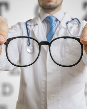 Oculist Doctor Is Offering Glasses To A