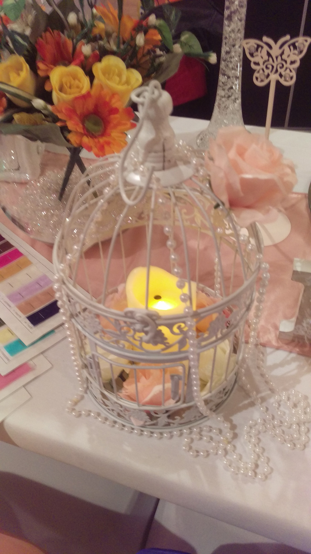 Bird Cage Centerpiece with Pearl Garland and Roses Wedding Venue Table Decoration by Embellish Venue Styling Kent - www.embellishvenuestyling.uk