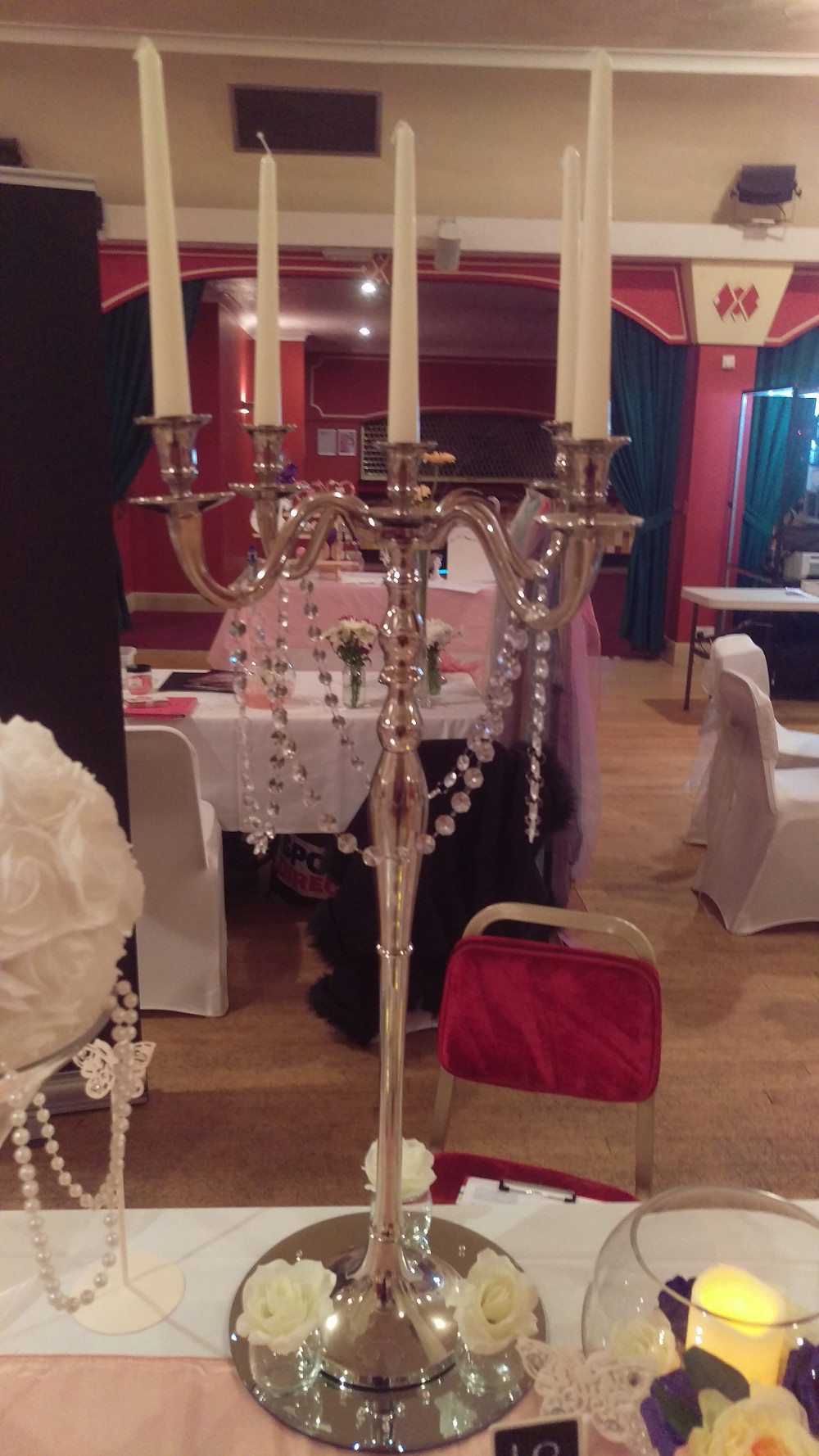 Silver Candelabra and Crystal effect Hanging Garland with Mirror plate and Rose Buds Wedding Venue Table Decoration by Embellish Venue Styling Kent - www.embellishvenuestyling.uk