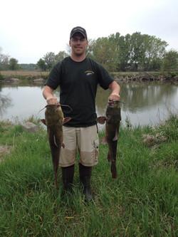 Ryan with two nice flathead catfish