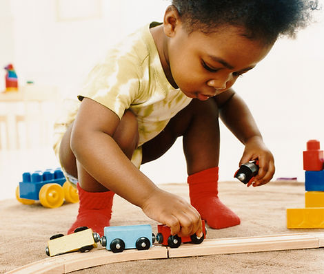 Child playing with train set
