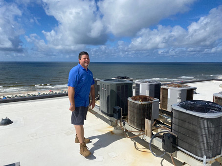 Juan Soto enjoying the view while checking out the A/C unit on top of this high rise condominium.