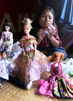 Putu with her handmade doll - PURE
