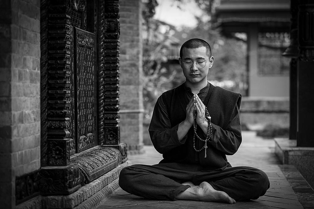 Monk is practicing yoga