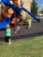 Preschool children playing outside playground