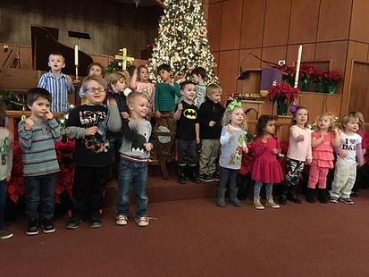 Preschool children singing church sanctuary