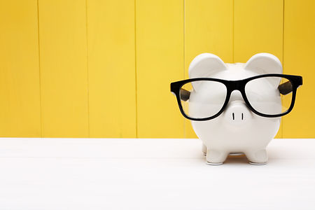 Piggy bank wearing a black glasses over