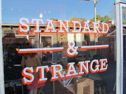 Standard & Strange window sign