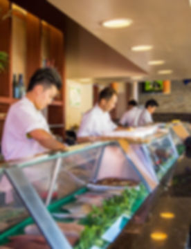 Chef at San Shi Go Laguna Beach making suhi for customer