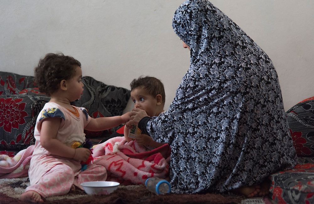Swasan feeds her children at her home in East Amman, Jordan, 12 June 2017. The name has been changed to protect the identity.