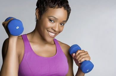 african_american_woman_weights_dumbbells_smile_workout_exercise