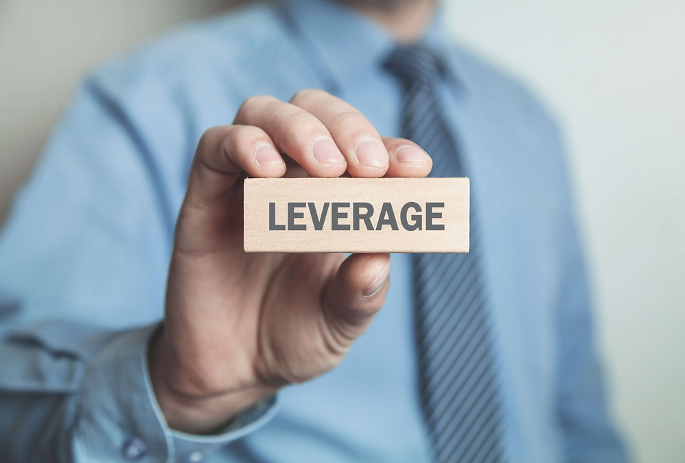 Leverage helps real estate investors build wealth by increasing their investment return 50% or more