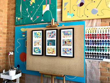 Postcard size Giclee prints in a frame. Three images in one frame. The background is Selva Veeriah's art studio.