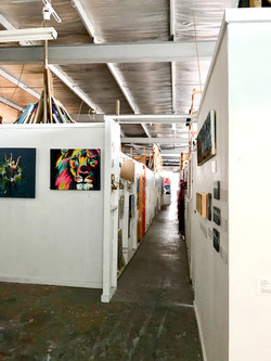 The corridor at Artists' Studio 106 (St Kilda) with studio rooms located on either side. There are a