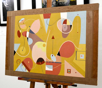 Abstract Painting titled S256 (2019) on an easel. Colourful, basic shapes, lines, yellow, red, blue.