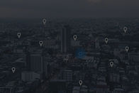 Searching location on map and pin above blue tone city scape and network connection, inter