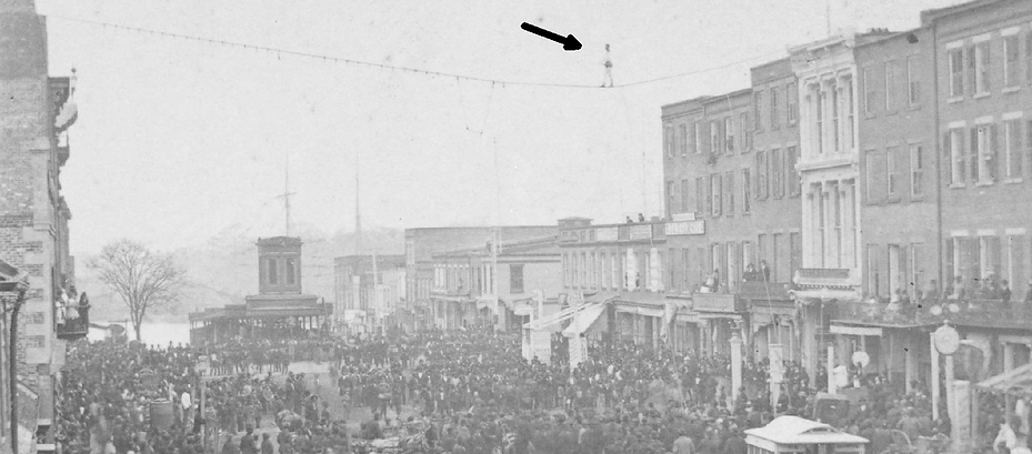 "First block and a half of Market Street in 1879.  Note the Old Market House and if you look closely at the top, you can see Professor ""Dare"" walking a tight-rope."