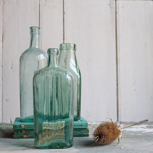 Three Reclaimed Green Glass Bottles