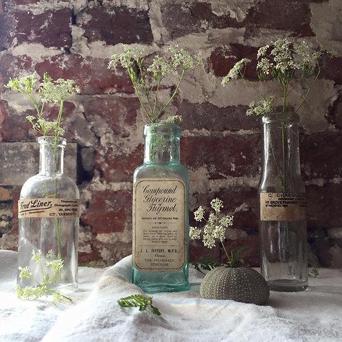 Three Old Pharmacy Bottles