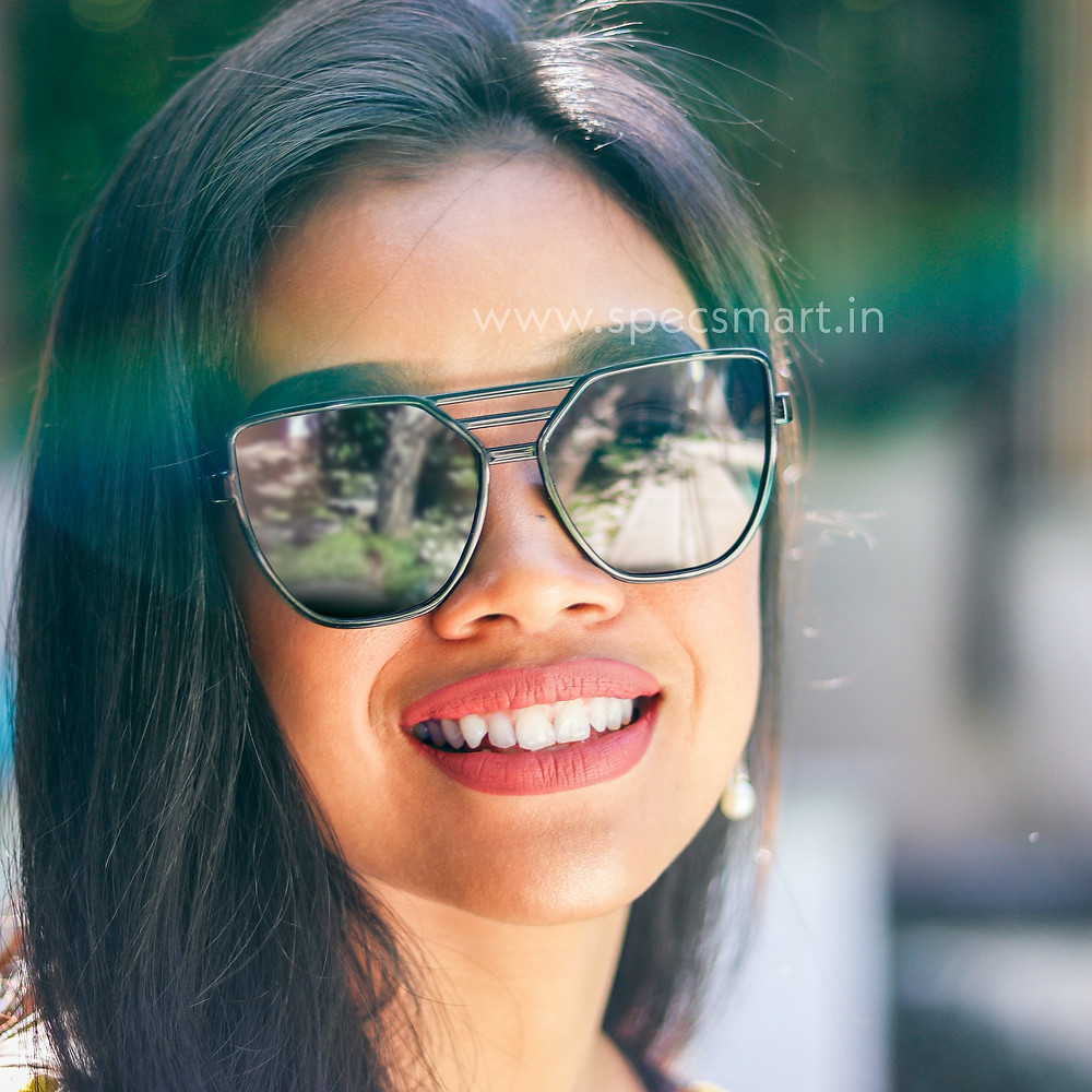 Girl wearing sunglass with smile