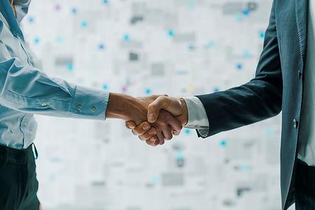 business-partners-shaking-hands-TQXY882.jpg