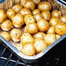 Seasoned-potatoes-on-smoker.jpg