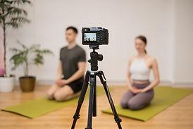 yoga-trainer-teaching-online-training-program-home-studio-camera-sport-instructors-showing
