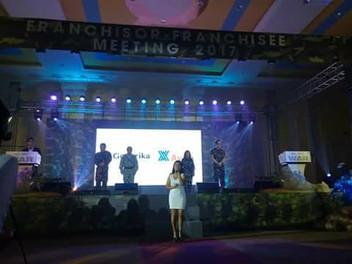 Singing at Generika's Franchise Meeting